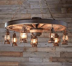 Large Wagon Wheel Chandelier with #rustic Lanterns Rustic Lanterns, Large Rustic Chandeliers, Wooden Chandelier, Hanging Lanterns, Outdoor Chandelier, Lantern Chandelier, Outdoor Lantern Lights, Wagon Wheel Chandelier Diy, Cabin Chandelier