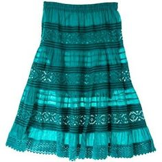Take your summer style with you all year long. The layered strips of sheer material and lace on our Teal Prairie Skirt create a textured bohemian look that is always in style no matter the season.