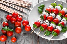 hristmas canapés Caprese salad - skewer with tomato, mozzarella and basil, italian food and healthy vegetarian diet concept Christmas Canapes, Christmas Party Food, Xmas Food, Christmas Cocktails, Vegetarian Canapes, Healthy Vegetarian Diet, Italian Appetizers, Appetizer Recipes, Cocktails And Canapes