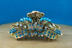 This hair clips ornate design and turquoise/aqua rhinestones make it a unique, eye-catching piece, sure to spice up any hair style. Its perfect Vintage Hairstyles, Wedding Hairstyles, Wedding Hair Clips, Aqua, Turquoise, Spice Things Up, Hair Accessories, Brooch