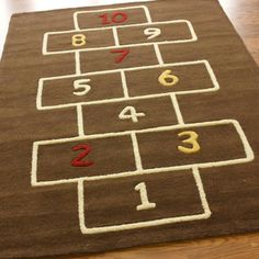 Hopscotch rug! But, be sure to have a non slip/skid backing on it so it won't move on the floor/carpet.