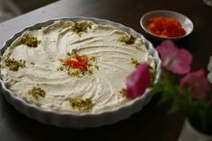 Lebanese nights semolina pudding: orange & rose blossom flavored pudding with pistachios, apricots, and whipped cream. Middle Eastern Desserts, Middle Eastern Dishes, Lebanese Desserts, Lebanese Recipes, Arabic Sweets, Arabic Food, Layali Lubnan Recipe, Semolina Pudding, Eastern Cuisine
