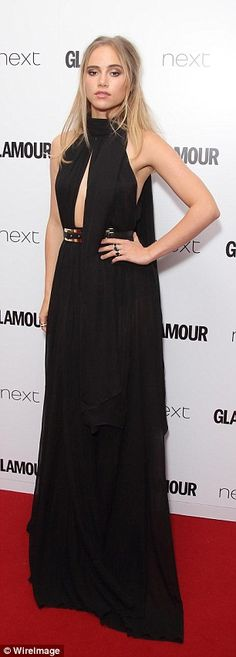 Model looks: Suki Waterhouse matched Kate by showing some skin in a draped black gown, whi...