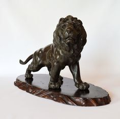 JAPANESE BRONZE STANDING LION BY SEIYA. Just Japanese antiques are based in Chichester, England.