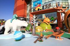 "Sculptures and lighting decorations are open to the public near a shopping mall in Beijing on November 25, 2014. ""Adventures in Forest"", a Latin-style landscape designed by Argentine illustrator Javier Gonzalez Burgos, was the first of its kind in the capital city."