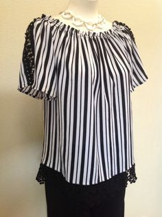 Vertical stripes in classic black and white get a touch of sweetness with crochet trim - August Silk - Black and white striped top with gathered neckline and crochet trim - #Casanovasdownfall #SummerStyle #Fashion #FashionInspo #Ootd