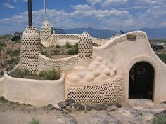 The construction methods are not new; this type of construction is closely related to indigenous building methods that have been used for centuries.  However, an architect and builder in New Mexico, Michael Reynolds, is the visionary behind building with garbage.  He has been using old tires, cans and bottles for decades, to create homes that are entirely self-sustaining and off the grid.  www.earthship.net