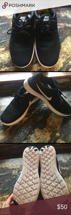 Nike Free tennis shoes Black with white swoosh and bottom. Worn 4X MAX! Perfect condition! Nike Shoes Athletic Shoes