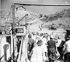 Workers disembarking from barge, ca. 1940. :: Grand Coulee Dam Construction