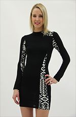 High neck, long sleeve mini dress with triangular tribal pattern contrast in the front, left side collar and sleeves. The fabric is soft and comfortable, and the back is a solid black but the tribal contrast on the sleeves is evident. Wear this adorable dress to your next family gathering.Details:- Rayon, Spandex- Hand Wash- Made is USA