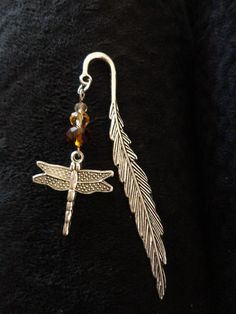 Items similar to Dragonfly In Amber Themed Bookmark, Antiqued Silver Tone, Scotland Inspired on Etsy Ruby Necklace, Drop Earrings, Craft Fair Displays, Dragonfly In Amber, My Bookmarks, Organza Gift Bags, Craft Fairs, Metallica, Antique Silver