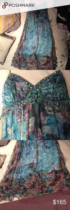 Stunning beaded silk Sue Wong formal dress size 2 Absolutely gorgeous dress. Sue Wong, 100% silk. Beautiful turquoise lining with overlying sheer silk floral print layer. Turquoise with purple accents. Beautiful beading on the top. Has ribbon that ties like a halter. Only worn once to my prom, so in basically perfect condition. Size 2 Sue Wong Dresses Prom