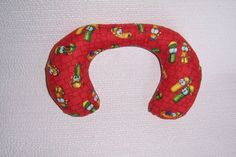 Baby Neck Roll Pillow with VEGGIETALES characters.