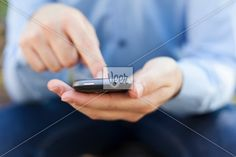Businessman with smartphone in hands Stock Photo