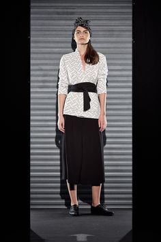 Button down criss cross shirt paired with black culottes and a kimono style tie waist from CASTRO's #FlavorsofFall fashion show