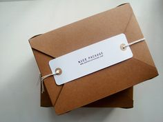 Envelope style packaging (envelop = packaging) with tissue and sticker inside