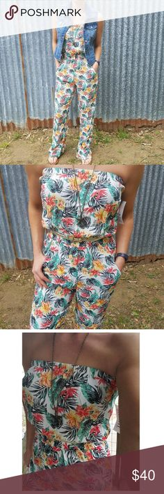 """NEW The Lucy Love Tropical Beach Aloha Jumpsuit The Lucy Love Tropical Beach Aloha One Piece Jumpsuit     NEW WITH TAGS  SIZE SMALL  RETAIL: $88  -One-piece jumper features lightweight fabrication and a retro-inspired look with a super cute tropical beach vacation print. -Strapless -Elastic waist for an hourglass silhouette. -Dual-hand pockets. Full-length pants with a slight flare. -100% rayon.  Has Stretch  Pit to Pit: 13""""  Elastic waist: 13"""" Full Length: 52"""" Inseam: 30""""  Model Info: Size…"""