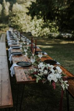 With black and burgundy decor organic floral pieces this outdoor reception had a moody feel Image by Maggie Grace Photography Wedding Venue Decorations, Wedding Table Centerpieces, Wedding Table Settings, Wedding Venues, Wedding Ideas, Diy Wedding, Picnic Table Decorations, Rustic Table Settings, Small Wedding Receptions