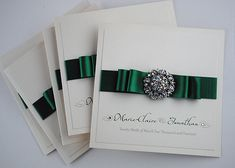 Purely elegant wedding invitations adorned with rhinestone gem.  These are invitations your guests will never forget.