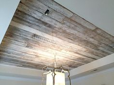 The pic doesn& even come close to how beautiful this ceiling looks in perso. The pic doesn& even come close to how beautiful this ceiling looks in person! We used our white washed barn wood skins to cover this master bedro. Trey Ceiling, Shiplap Ceiling, Wood Ceilings, Wood Plank Ceiling, Accent Ceiling, Timber Ceiling, Look Wallpaper, Wallpaper Ceiling Ideas, Bedroom Ceiling