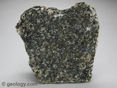 Gabbro is a coarse-grained, dark colored, intrusive igneous rock that contains feldspar, augite and sometimes olivine. The specimen shown above is about two inches (five centimeters) across.