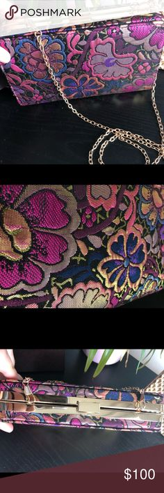 Floral and gold evening clutch w/removable strap. Beautiful floral pattern has gold woven throughout, making this clutch a true statement piece for any outfit. Looks beautiful with an LBD and provides an elegant pop of color. Gold strap is removable. All black interior with small pocket. Only used once, in perfect condition. Firm on price- I love this bag! n/a Bags Clutches & Wristlets