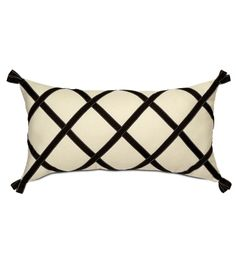 I like the criss-cross design on this pillow.  This could easily done with ribbon and hand stitched.