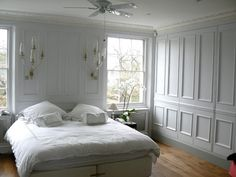bedroom storage within the room rather than a walk in closet- loving the panelled doors so the room doesn't looked chopped up