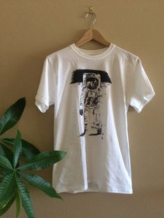 Another one of our favorite designs from over the years, this shirt features a sketch of the famous moonwalker photo. Its super hip and sure to