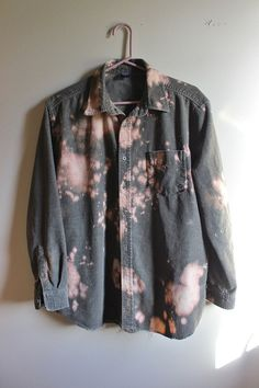 This is a distressed vintage soft olive green corduroy shirt.  Weve strategically splatter bleached it all over and distressed/ frayed it along the bottom hem and cuffs .  Heres your info on it -  - Size Large, check measurements - Across chest flat, pit to pit - 24 (48 around)  - Shoulder seam down, front - 28  - Shoulder seam down , back - 30  - Shoulder seam to cuff - 23  If you need more info or have any questions, just yell, were around to help you out.  If youre ordering from a…