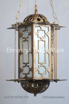 Arabic Style Brass Lantern with White Colored Glass - CH-109  The weight is 4.45 KG approximately. The height is 45cm without chain and with chain is 70cm and 30cm width from the widest point approximately.  The Brass Lantern Handmade in Egypt, the Lantern body is 100% made of Brass With White Colored Glass, it can be used in the dining rooms, bedrooms, or empty corners.  It adds a uniquely foreign touch to your home!