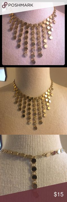 Gold Tone Fashion Bib Necklace Gold tone bib necklace. Update any outfit with this stylish accessory. Adjustable clasp. Jewelry Necklaces