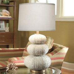 Fun seaside lamp with 3 white stacked sea urchin base.