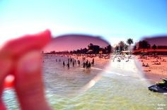 what a neat-o idea: when taking a photograph, put the lense of a pair of sunglasses in front of the camera. I am so trying this!