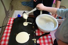 Making pancakes on a hot plate!