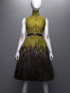 Alexander McQueen -   Dress:   Eshu, autumn/winter 2000–2001.  Yellow glass beads and brown horsehair.