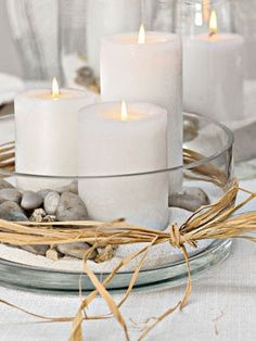 natural candle arrangement--use some color to break up neutrals... Put a tall bottle with a stem or two in the middle!!