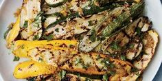 Bagna cauda, the simple Italian sauce of olive oil, anchovies, and garlic, flavors strips of grilled zucchini and yellow squash.