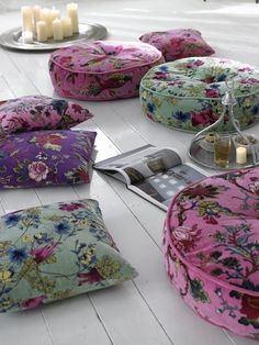Large colorful floral floor pillows for extra seating