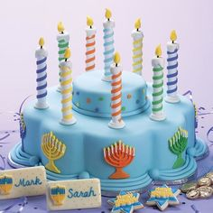 Even if your menorah candles burn too quickly, you?ll have the bright lights of this cake to admire throughout the celebration. For the spiral design, just wind strips of tinted fondant around dowel rods.