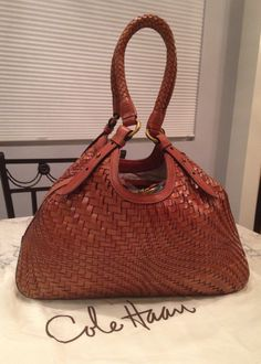 Cole Haan Genevieve Woven Leather Hobo Satchel Handbag Saddle Brown Cognac Tote Bag. Get one of the hottest styles of the season! The Cole Haan Genevieve Woven Leather Hobo Satchel Handbag Saddle Brown Cognac Tote Bag is a top 10 member favorite on Tradesy. Save on yours before they're sold out! GORGEOUS!!! BEAUTIFUL SADDLE BROWN/ COGNAC BROWN COLOR!!! EXCELLENT CONDITION!!! SALE!!! WOW!!!
