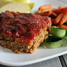 This Zucchini Meatloaf is moist and tastes amazing! 2 eggs, slightly beaten 1 cup shredded zucchini (1 large or 2 small) 1/2 cup of Italian Bread Crumbs 1/2 cup chopped onion 1 teaspoon salt  1/2 teaspoon dried oregano leaves 1/4 teaspoon pepper 1 pound lean ground turkey - Topping - 2 Tablespoons of packed brown sugar 1/4 cup of ketchup 3 Tablespoons of Dijon Mustard