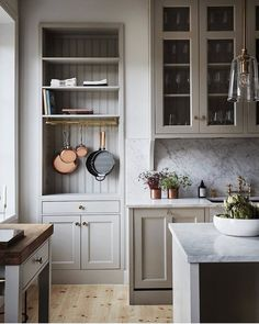 A serene farmhouse kitchen design with warm putty gray painted kitchen cabinets, beadboard, and marble backsplash in a gorgeous classic kitchen. Neutral Cabinets, Grey Kitchen Cabinets, Kitchen Soffit, Colored Cabinets, Kitchen Shelves, Warm Grey Kitchen, White Cabinets, Minimal Kitchen, Classic Cabinets