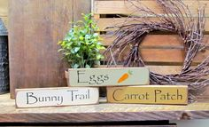 """This set of 3 Easter / Spring stackable signs measure 9"""" Long by 2"""" High. They look great on a shelf, window sill, atop of a door or just randomly scattered. One is painted sage green, one mustard yel"""