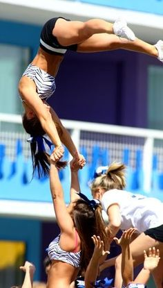 Our cheerleaders in Zebra print sport bras and stunting?! I wish!! (: