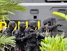 Indonesian elite anti-terror police unit 'Densus 88' stage an assault on 'mock terrorists' holding hostages at the Borobudur hotel during an anti-terror exercise in Jakarta on March 13, 2010. Indonesian police and the military launched a series of anti-terror exercises on March 13, a week ahead of a visit to the country by US President Barack Obama.