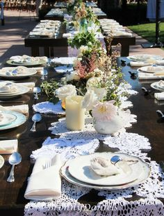 Handmade doily runners, mismatched vintage plates, blue mason jars....wedding....island cowgirl style.