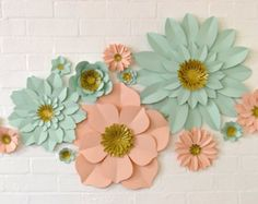 A stunning set of paper wall flowers for a floral backdrop or wall installation.  This set of 11 paper flowers is perfect for a photo or ceremony backdrop. They really add the wow factor to a wedding or any special occassion! This listing is for the kit, which comes with photo instuctions and sticky fixers. Once made up these flowers are suprisingly sturdy, treat them well and you can use them again and again!  Available in 40 different colours! Please leave your colour choice in the…