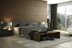 The Captivating Natural Wood Accent Bedroom Has Bedside Table, White Lamps, Wood Floors, a Rug, Large Windows and Curtains