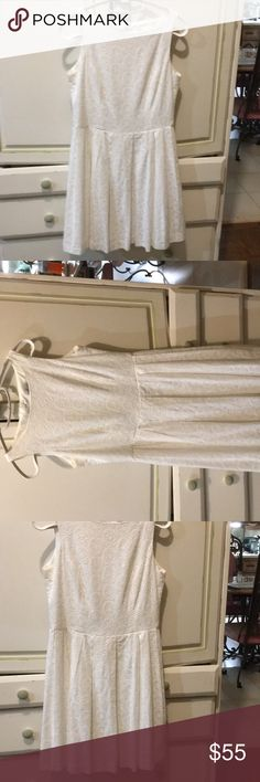 Cupcakes & Cashmere white eyelet dress lined SZ4 New without tags beautiful white eyelet dress lined w/ zipper Closure by Cupcakes and Cashmere SZ4 I just love white dresses worn with denim jackets and boots but add your own flair even nice with a scarf .... great versatile dress Enjoy 😊 Cupcakes and Cashmere Dresses Midi